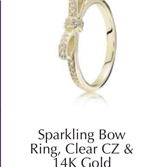16c936350 Pandora 14k gold sparkling bow ring. M_5b5f3f587ee9e25c7219f442
